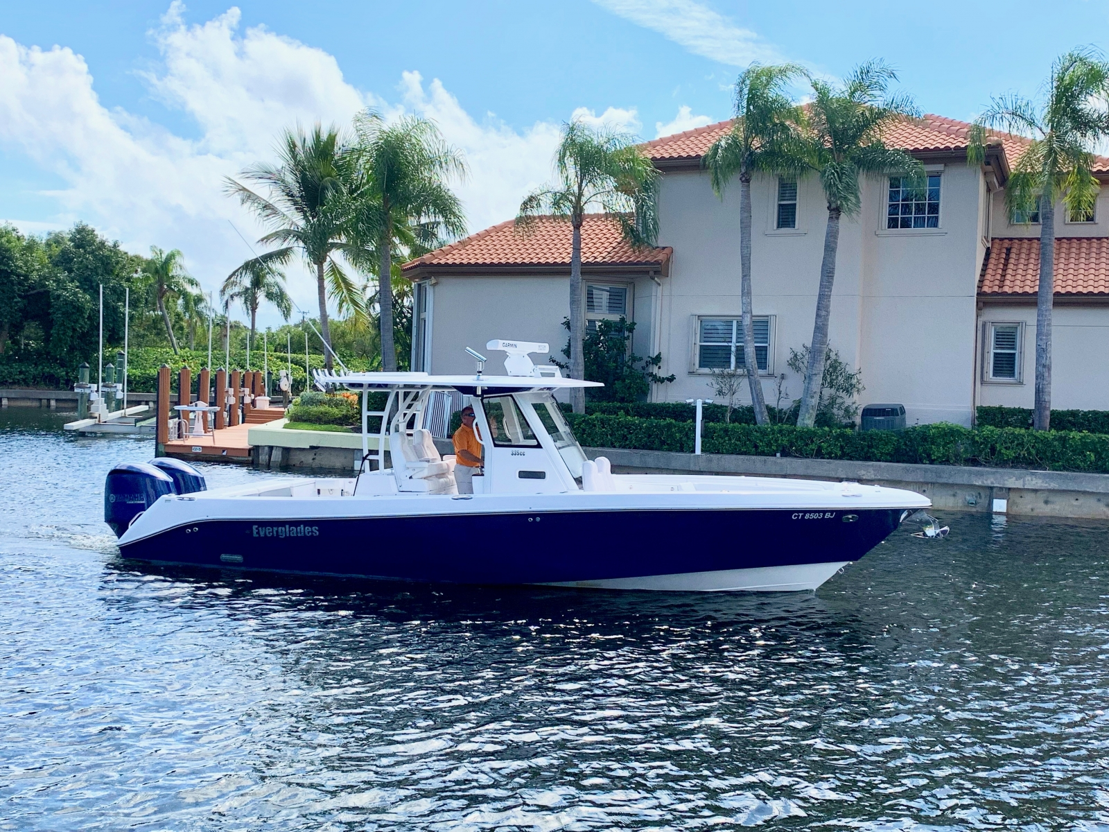 Blue hulled 2019 Everglades 335 on the water
